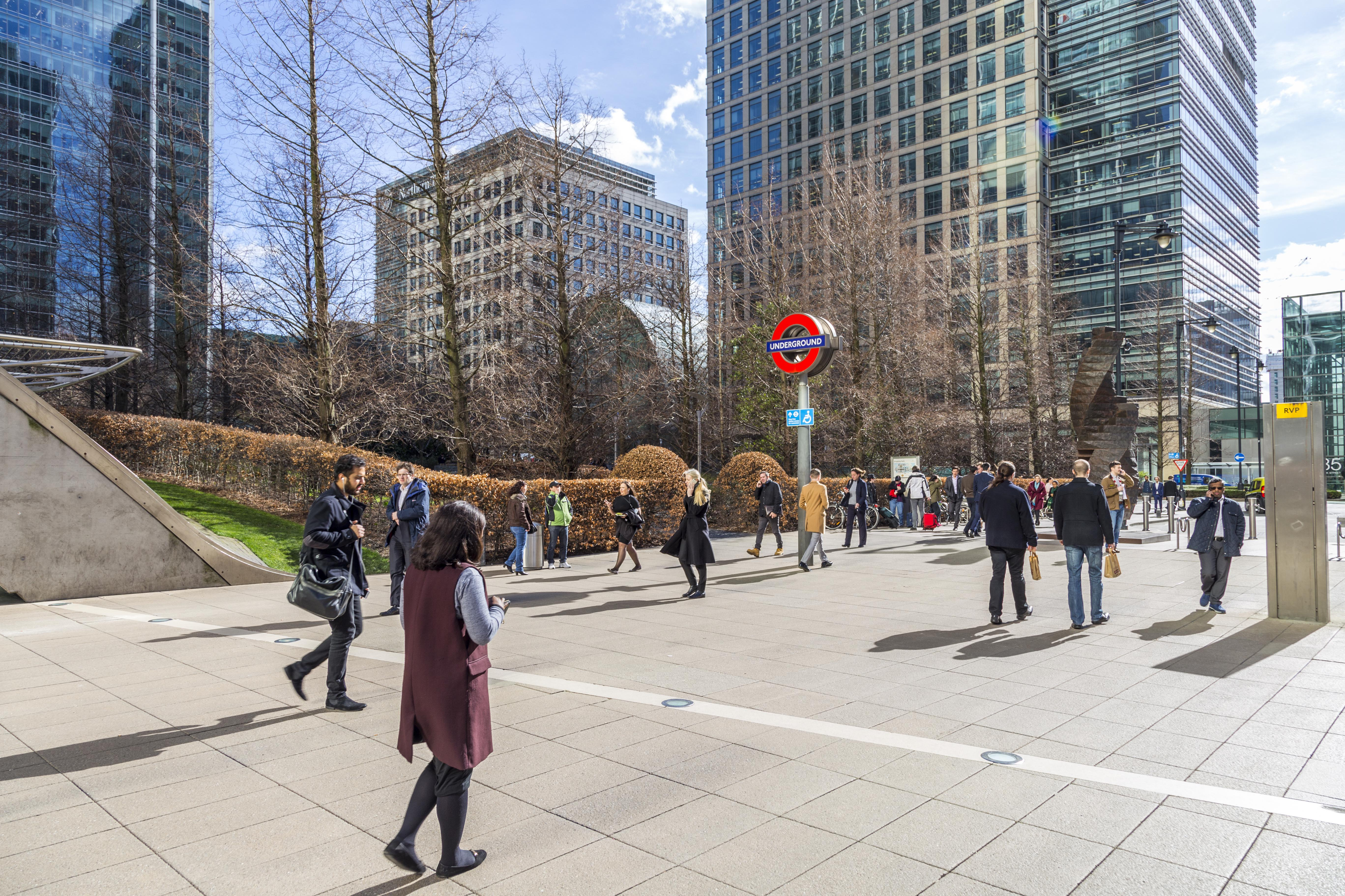 A sunny day outside Canary Wharf station in London