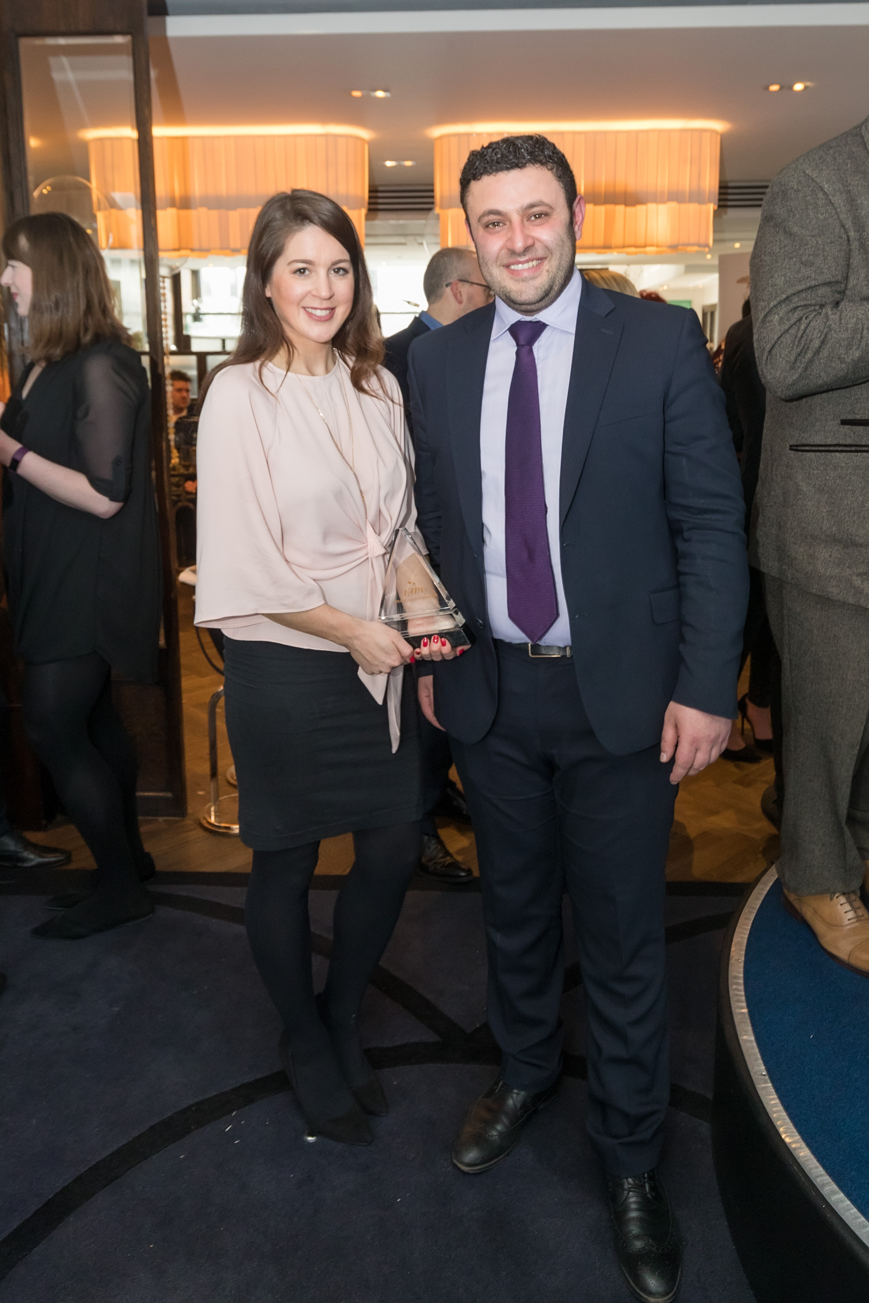 Hannah and Shadey holding the award for best lettings agent and smiley